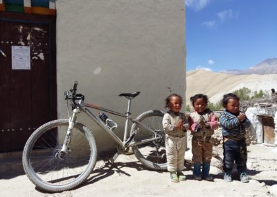 The local children don't get to see too many mountain bikes in Upper Mustang