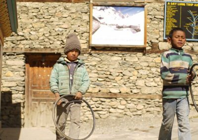 Boys playing with hoops in Pisang, Nepal