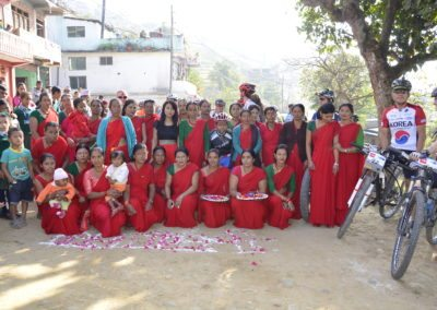 Local women folk welcome the riders  near Gorkha